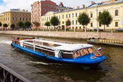 Pleasure tourists boat on the river Moika in St. Petersburg Royalty Free Stock Images
