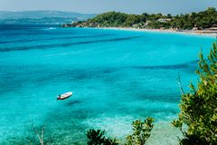 Pleasure white boat in crystal clear blue sea water. Spectacular Platis Gialos and Makris Gialos Beach, Kefalonia island stock photos