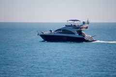 Pleasure yacht in the sea. In summer Royalty Free Stock Images