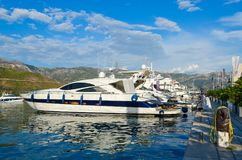 Pleasure yachts at pier in Dukley marina near promenade of Budva, Montenegro Stock Photography