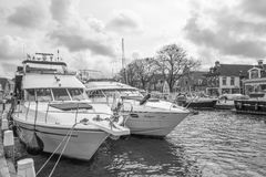 Pleasure yachts in the port of Lemmer. NETHERLANDS - LEMMER - MEDIA APRIL 2017: Pleasure yachts in the port of Lemmer in Friesland, Netherlands stock photos
