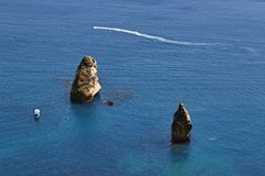 Pleasure yachts of the rocks. Into the sea on a clear sunny summer day. View from the top Royalty Free Stock Images