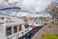 Pleasure yachts and sail boats in the port of Lemmer. NETHERLANDS - LEMMER - MEDIA APRIL 2017: Pleasure yachts and sail boats in the port of Lemmer in Friesland stock photos