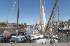 Pleasure yachts and sailboats. NETHERLANDS - LEMMER - MEDIA AUGUST 2015: Pleasure yachts and sailboats in the port of Lemmer in Friesland, Netherlands stock images