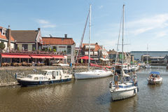 Pleasure yachts and sailboats in the port of Lemmer in Friesland, Netherlands. NETHERLANDS - LEMMER - MEDIA AUGUST 2015: Pleasure yachts and sailboats in the royalty free stock photography