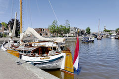 Pleasure yachts and sailboats in the port of Lemmer. NETHERLANDS - LEMMER - MEDIA AUGUST 2015: Pleasure yachts and sailboats in the port of Lemmer in Friesland royalty free stock image