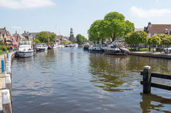 Pleasure yachts and sailboats in the port of Lemmer. NETHERLANDS - LEMMER - MEDIA MAY 2014: Pleasure yachts and sailboats in the port of Lemmer in Friesland stock images