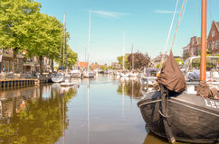 Pleasure yachts and sailboats in the port of Lemmer. NETHERLANDS - LEMMER - MEDIA MAY 2014: Pleasure yachts and sailboats in the port of Lemmer in Friesland royalty free stock images