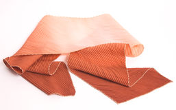 Pleated brown and cream scarf Stock Images