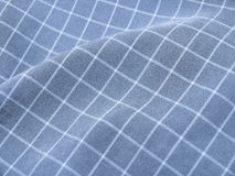 Pleated checkered blue fabric Stock Images