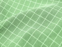 Pleated checkered green fabric. Creased checkered green fabric closeup. Good for background Stock Images
