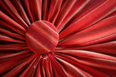 Pleated fabric red with head studs close up Royalty Free Stock Images