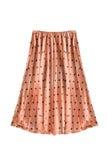 Pleated skirt. Beige pleated chiffon skirt on white background Stock Image