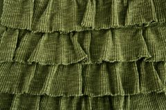 Pleated skirt fabric fashion in green closeup Stock Photo