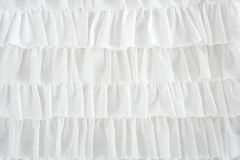 Pleated skirt fabric fashion in white closeup. Detail macro Royalty Free Stock Photography