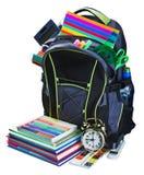 Plecak dla szkolnego materiały uczenie odizolowywającego obraz royalty free