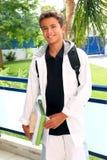 plecak rezerwuje chłopiec mienia ucznia nastolatka Obraz Royalty Free