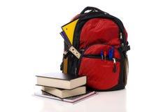 plecak rezerwuje czerwieni szkoły Obraz Royalty Free