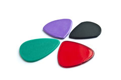 Plectrum. Four differently colored plectrum to play the guitar royalty free illustration