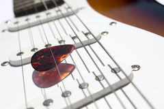 Plectrum among strings Stock Images