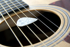 Plectrum on strings Royalty Free Stock Photos