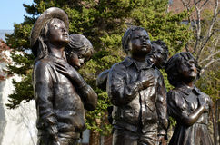 Pledge of Allegiance - Holland, Michigan. The Pledge of Allegiance is a patriotic sculpture of children saluting the American flag. The statues by Glenda Stock Photography