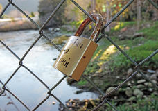Pledge hedge with locks along river Stock Image