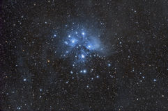 The Pleiades. This blue reflection nebula and star cluster is known as The Pleiades, or Seven Sisters.  It is part of the Taurus constellation Stock Image