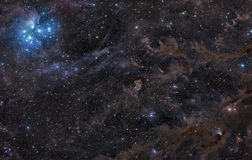 Pleiades Nebula in Surrounding Dust Royalty Free Stock Image