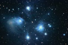 The Pleiades reflection nebula in the constellation of Taurus. O. Pen star cluster. Astrophotography royalty free stock images