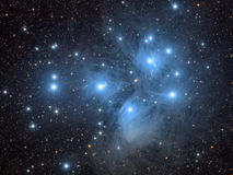The Pleides, or Seven Sisters. High resolution image of the Pleiades and the accompanying, wispy reflection nebulae Stock Photography