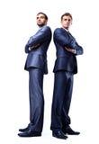 Plein corps de deux jeunes hommes d'affaires heureux Photos stock