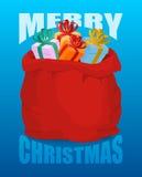 Plein sac à Santa Claus de Joyeux Noël de cadeaux Sac de avec pré Photo stock