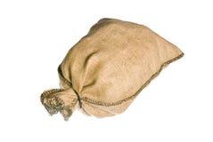 Plein sac à toile de jute d'isolement Photo stock