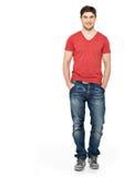 Pleine verticale d'homme bel heureux dans les vêtements sport Images stock