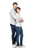 Pleine verticale des couples heureux d'isolement sur le blanc Images stock