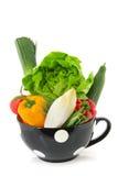 Pleins légumes de cuvette noire Photographie stock