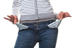 Pleite young woman showing her empty pockets. Young teenage girl shows the empty trouser pockets Stock Photography