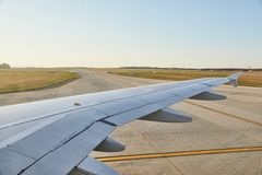 Plene at takeoff. Airplane lining up for takeoff sunny weather Royalty Free Stock Photos