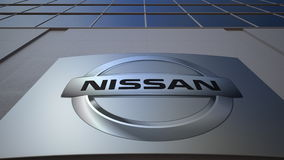 Plenerowa signage deska z Nissan logem zbudować nowoczesnego urzędu Redakcyjny 3D rendering Zdjęcia Royalty Free