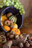Plenty. Thanksgiving table and wooden board filled with autumn products Royalty Free Stock Photos