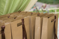 Plenty bag with present near curtain. Stock Image