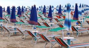 Plenty of beach chairs and umbrellas Stock Image