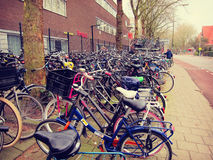 Plenty bicycles parked on the Dutch street, Netherlands, urban h Royalty Free Stock Image