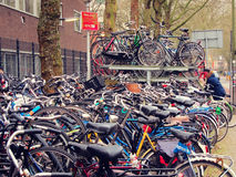 Plenty bicycles parked on the Dutch street, Netherlands, urban h Stock Photos