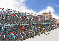 Plenty bicycles at parking lot in Stock Images