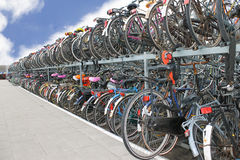 Plenty bicycles at parking lot in Royalty Free Stock Images