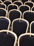 Plenty of blue chair backrests with metal borders