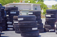 Plenty of Brand New Tires Located Outside of the Auto Repair Sho Royalty Free Stock Image