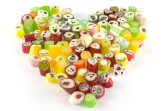 Plenty candies in heart shape Royalty Free Stock Photos
